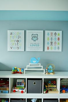 I love the blue and gray of this nursery with the natural light. Plus the personalized artwork is awesome. I think the site  they are from, piecemaker.com will come in handy for gifts from this auntie.