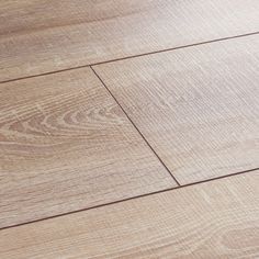 Vintage Mink laminate flooring features a striking yet sophisticated blend of ashen gold hues in a rustic-style board. Get a free sample.