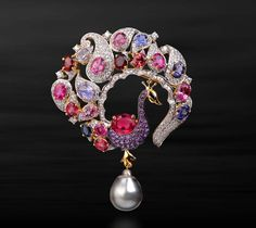 Farah Khan's peacock brooch, set with a pearl, diamonds and multi-coloured gemstones..