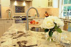 Delicatus White Granite with White Kitchen Cabinets