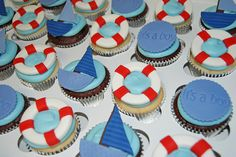 nautical themed baby shower cupcakes - sailboats, life preservers by Simply Sweets, via Flickr