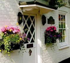 Hanging flower boxes are a great way to liven up a door without cluttering the ground.