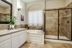 Traditional Master Bathroom with Undermount Sink, Oval Ceramic Undermount Bathroom Sink in Biscuit by Ronbow, Wall sconce