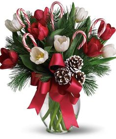Here's the perfect hostess gift - By Golly It's Jolly - a beautiful Christmas bouquet of bright red and white tulips, real candy canes, pinecones and holiday greens in a pretty ginger vase with a holiday bow. Christmas Flower Decorations, Christmas Flower Arrangements, Christmas Flowers, Christmas Centerpieces, All Things Christmas, Christmas Holidays, Christmas Wreaths, Christmas Crafts, Merry Christmas