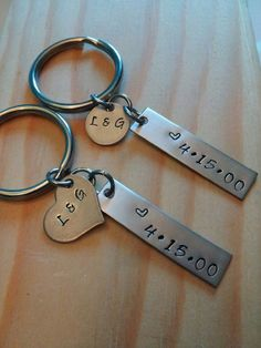 *******Please read entire description*********....  Hand Stamped Personalized Key Chains - You get both Key Chains!  Here is what the you get:  1st Keychain  x1 - 3/8 x 1 1/2 Stainless Steel Bar - Stamped with - Heart - Date x1 - .5 Stainless Steel Disc - The Initials of the couple x1 - 1 Steel Split Ring  2nd Keychain  x1 - 3/8 x 1 1/2 Stainless Steel Bar - Stamped with - Heart - Date x1 - .5 x .75 Stainless Steel Heart - The Initials of the couple x1 - 1 Steel Split Ring   *****Please add…