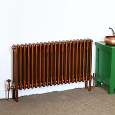 A classic column radiator finished in a copper lacquer. Flat Panel Radiators, Vertical Radiators, Column Radiators, Stainless Steel Radiators, Brushed Stainless Steel, Steel Columns, Designer Radiator, Red Dot Design, Aluminum Radiator