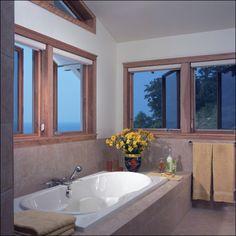 Natural light creates a relaxing bathroom with spacious bathtub Photo by James Yochum