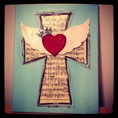Cross and wooden wing canvas with felt heart and rhinestone crown.