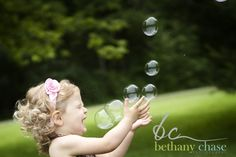 Bubbles! Too cute!!  I would love to do this for my daughters 1 year pictures.