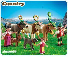 Figuren: 1 Mann, 1 Frau, 1 Mädchen ; Tiere: 3 Kühe, 1  Kalb, 1 Ziege ; Zubehör: 1 Hut, 1 Trachten-Schürze, 3 große Kuhglocken, 2 kleine Kuhglocken, 3 x Kuh-Kopfschmuck