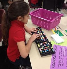 Daily 5: Work on Words=Type-it is one that they race for. I just took an old keyboard and fancied it up with cutesy stickers. They type their words. I get a kick out of watching them do this. Some of my girls take it so seriously and act like they are at the office.