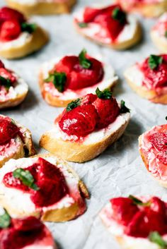 Gorgeous roasted strawberries paired with creamy goat cheese and fresh basil on top of crispy crostiniAn incredible summer appetizer that's perfect for entertaining!