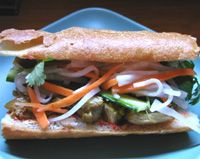 Vietnamese Banh Mi Sandwich: roasted meat or tofu topped with pickled daikon and carrot, cilantro, cucumber, jalapeno, all on a baguette roll.  These are so good!