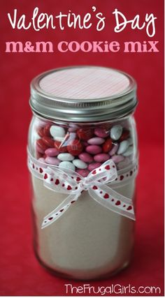 Valentine's Day M&M Cookie Mix in a Jar! ~ from TheFrugalGirls.com ~ this quick and simple cookie mix makes the most DELICIOUS cookies, and such a fun gift! #valentinesday #masonjars #thefrugalgirls