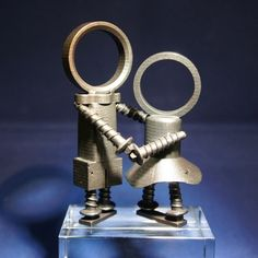 """The Scrappies - Dancing Couple - A series of originally designed small sculptures in scrap metal-look.The body parts of the Scrappies are inspired by everything that can be found in a scrapyard:  Old bolts and nuts, rusty coils, pipes, parts of ball bearings, tin cans & more. The figurines are worked out in minute detail, including """"rust holes"""" and traces of an alleged """"welding"""". The sculptures are available in different materials and sizes"""