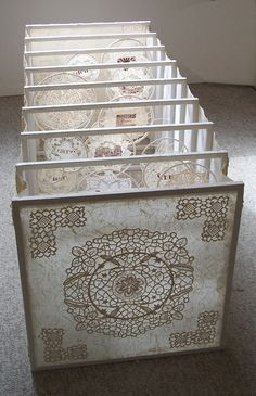 Connect, artist book by Jane Merks. This tunnel book celebrates the beautiful craft of old doilies. 61 cm x 61 cm x 183cm, kozo paper, old doilies, wood, string and wire. March 2007
