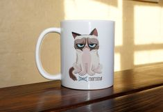 Grumpy Cat Coffee Mug by 312INK on Etsy, $22.00   This is literally what I say and how I look in the morning.