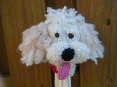 Goldendoodle knit golf club cover.