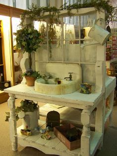 potting bench made from an old window and cast iron sink. darling!