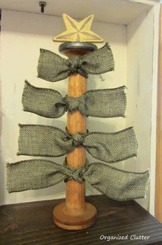 Oh are you kidding me... this is adorable!!  Easy Wooden Spool Christmas Decor www.organizedclutterqueen.blogspot.com.