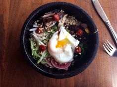 The Hot Stone Rice Bowl with kale, mushrooms, and pickles is a highlight of the Wild at Canelé menu.