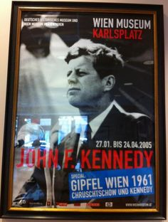 The Wien Museum in Germany announced an exhibit featuring the historical meeting between Soviet Union Nikita Kruschev and US President John F. Kennedy in 1961.  This large poster features the black and white image of John F. Kennedy and the dates of the exhibit in 2005.  Archival framed.