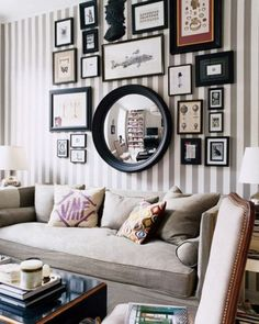 Home decor details. Picture frames combined with mirrors and detailed wallpaper. This type of decor would require a large room as it is a very heavy type of decor.