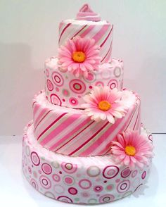 Baby Girl diaper cake ~ this is how I build my layers with the receiving blankets wrapped around all the layers.