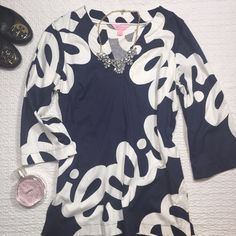 Lilly Pulitzer Tunic Top Adorable tunic with signature loopy Lilly print, only worn a few times and in excellent condition! 3/4 sleeves and slits on the sides. Lilly Pulitzer Tops Blouses
