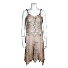 Stunning sleeveless 1920's rose pink silk chiffon cocktail dress is heavily embroidered with metallic glass bugle beads and dimpled silver foil sequins.