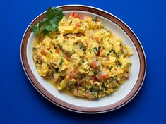 This quick breakfast dish is made a la Mexicana with red tomatoes, white onions, and green jalapeños, ingredients that mirror the colors of the Mexican flag.