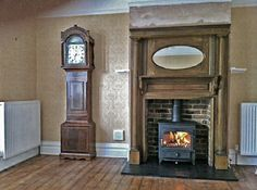 Antique arts & crafts oak mantel with reclaimed brick slip chamber, slate tiled hearth and Clearview Vision 500 multi fuel stove, Fitted in ...