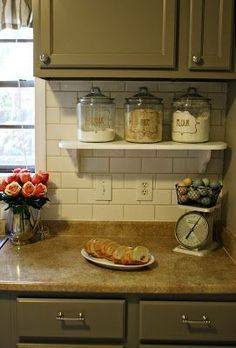Use a small shelf to have things accessible but off the kitchen counter. Small kitchen solutions.