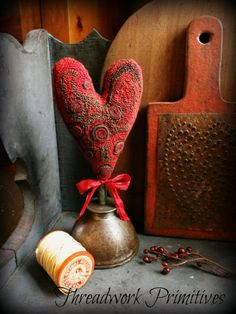 Got my wooly punched heart stuffed and mounted on an old oil can spout.  This was fun and actually very easy...now I'm in the mood for more...