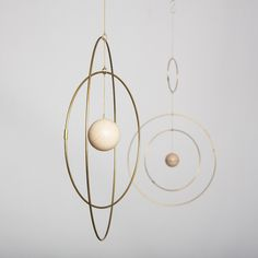 GO TO SHOP Galaxy Globe is a collection of eloquent mobiles, made from light brass rings that slowly move around each other with a marble sphere in the center, resembling…