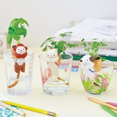 Clever Animal Planters with Self- Watering Tail. Adorable Shippon animal ceramic planters with clever siphon tails. The fabric tail soaks water up into the planter feeds the plants!