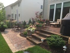 : Raised patio with steps down to a second patio space.  Two Level Patio.