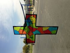 Stained Glass Cross. Simply requires two pieces of vinyl, permanent markers, and a stained glass cross to trace. #1 Trace the outline of the cross and glass. #2 Shade in each piece (4 colors works well). #3 Stick the second piece of vinyl on top (it will stick because of the wet marker). #4 Cut out your finished cross. This could also work with a decorative Easter egg. :) SO easy and fun!
