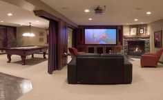 open basement reno with big screen tv and pool table for-the-home