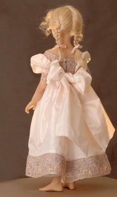 Awwww....sweet little real looking child-like doll.