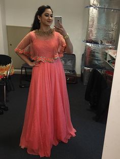 The Stylish And Elegant Gown In Pink Colour Looks Stunning And Gorgeous With Trendy And Fashionable Fabric Looks Extremely Attractive And Can Add Charm To Any Occasion. Indian Fashion Dresses, Indian Gowns Dresses, Dress Indian Style, Indian Designer Outfits, Indian Wear, Pink Gowns, Long Gown Dress, Cape Dress, Long Frock