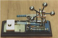Twin Cylinder Marble Engine with unique flywheel. (Scroll down the page to see it. There are many other engines on the page.)