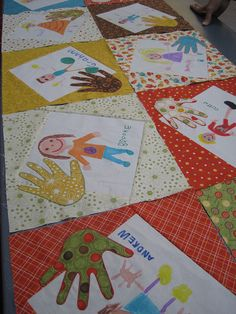LOVE the kiddie hand prints! This would be so cute for Jamie's kindergarden class.