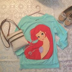 Little Mermaid tee This 3/4 sleeve length tee is an essential for mermaid lovers! The tee features a whimsical rendition of our favorite mermaid princess. Only worn once and in perfect condition! Disney Tops Tees - Short Sleeve