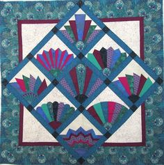 This is the quilt I have on the design wall today.    I am trying to decide if I want to quilt it myself or have a long arm quilter quilt it...