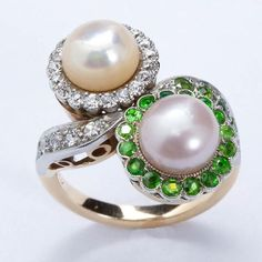 Twin natural pearls set in platinum and 14 karat gold with diamond and demantoid skirts. Pearls are 7 mm. Ring size 4-1/2 US (complementary re-sizing). No. 2864