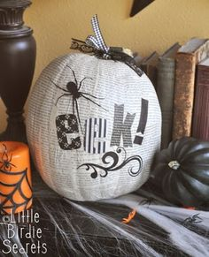 #DIY Halloween decor: Pumpkin decoupaged with newsprint/paper.