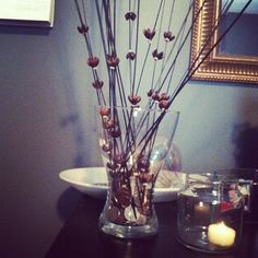 DIY change storage using a vase and Pier 1 Coco Rib Flower Bunch