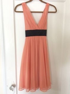 Forever 21 coral dress with black satin tie at waist.   Size Small. Worn once, excellent condition.  $25 shipped in U.S.