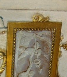 "Detail of an arabesque panel representing ""Autumn.""  Note the Snails on either side of the horizontal grisaille reserves.The Serilly Cabinet. Jones Collection."